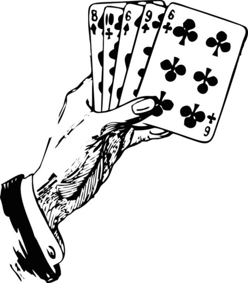 Playing cards in the hand of a gambler
