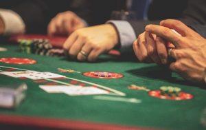 players gambling at a blackjack table